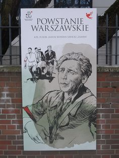 "A poster of Polish resistance fighter Janusz Sawicki (code name ""Zabawa"") in the Freedom Park of the Warsaw Uprising Museum...."