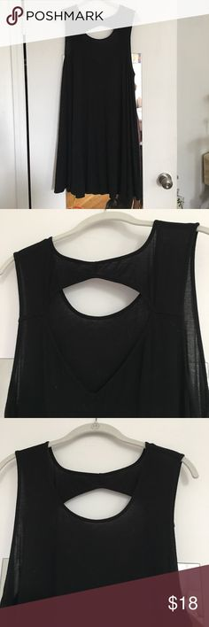 Black tent dress with back cutout Lovely, swingy black dress with fun cut-out detailing in the back. It's knee-length in a super soft stretch jersey. Size L from American Eagle. Great condition. American Eagle Outfitters Dresses Mini