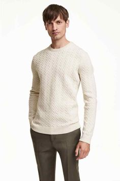 9dc152bbf260 Long-sleeved cable-knit sweater in lambswool with a rounded neckline and  ribbing at