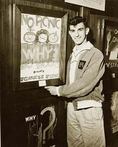 """No Picnic"" - Frank Zappa poses with the award-winning poster he created in 9th grade for an annual California Division of Forestry competition"
