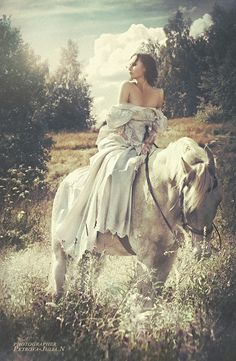 Princess Briah rides the wintry white horse that her father, the King, Devereaux had given to her as a young girl.