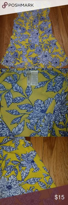 Really pretty wrap around shirt Beautiful color yellow has a blue and white floral design printed on it it's very silky fabric with wrap around tie at the waist, really flattering. japan Tops Tees - Short Sleeve