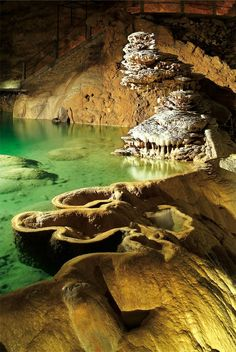 Padirac Cave, France. The most amazing cave structure, and you go in a boat to visit it!