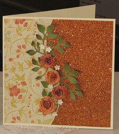 Warm toned rolled roses and lovely glitter paper.