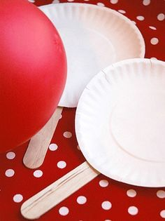 """Make paddles with Popsicle sticks and paper plates....use a balloon to play """"ball"""" in the house."""