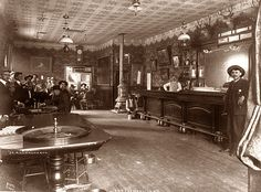 Also, those old saloons had a few spittoons where the barstools are, but not…