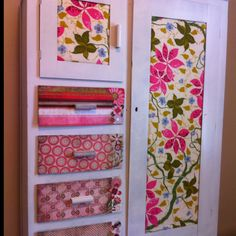 An antique wardrobe updated with fabric and scrapbooking paper