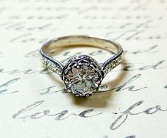 Sterling Silver Swarovski CZ Floral Band Ring with Tiara Crown like bezel  ( etsy :: http://www.etsy.com/listing/93611482/vintage-engagement-sterling-silver )