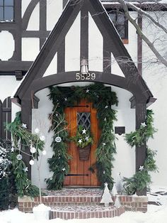 The exposed wooden beams and wood front door on this Tudor-style house give it a country quality that inspired its woodland scheme. Trim color ideas for our Tudor. Tudor Cottage, Storybook Cottage, Storybook Homes, D House, House Front, Exterior Paint Colors, Exterior Design, Casas Tudor, Tudor House Exterior