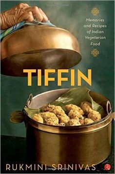 ...as I dug into my memory for those snacks or tiffin...I recalled the many anecdotes and narratives about the people and places associated with these recipes... My replies grew into lengthy stories and my girls loved them. Amma, send us more recipes for tiffin, they wrote... Those stories were rambling and multifaceted and they are all here in my book. Tiffin , derived from tiffing , a historical British term for small meals or snacks to accompany a drink, is a staple meal in most Indian…