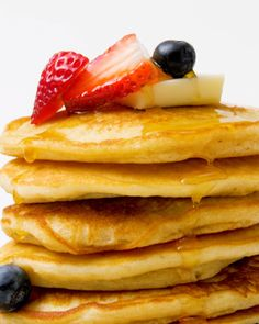 Super easy Copycat recipe for fluffy IHOP Pancakes - Thanksgiving.com #pancakes #brunch #copycatrecipes