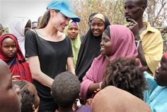 A great shot of Angelina Jolie helping poor people. Go Angelina