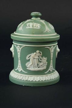 Vintage Wedgwood green jasper jar and cover with white classical motif