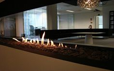 Open up your apartment, by connecting two rooms with a discreet fireplace.