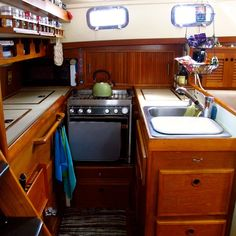 Technically a boat, but still a compact and efficient kitchen...Windtraveler: Making a Boat a Home: The Art of Decorating A Boat