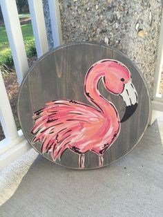 This hand painted flamingo is sure to light up any room! Its distressed edges and round shape gives this piece an added bit of character as well. Its painted on a 18 x 1 piece of wood which can be stained your choice of 3 colors (shown in picture). Flamingo Craft, Flamingo Painting, Flamingo Decor, Pink Flamingos, Stone Painting, Painting On Wood, Painted Rocks, Hand Painted, Painted Wood