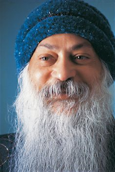 Osho-  Professor of philosophy,  Indian mystic, guru, and spiritual teacher.  No he is not that dude from ZZTOP