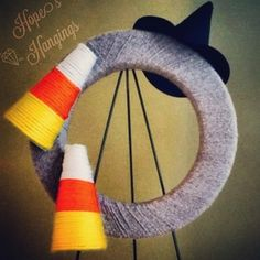 Candy Corn Yarn Wreath - $20 (Halloween discount)  www.facebook.com/hopeshangings