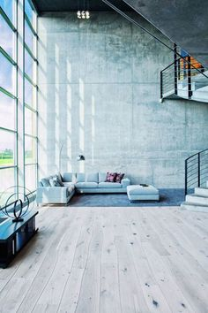 Normally, most of us would want to hang something on this vast wall but sometimes there's something about leaving it bare. This room has enough wall estate but leaving it as is is actually more impactful and grounds the room despite the space the minimal furniture is furnishing (the oversize, cool-hued rug helps too).