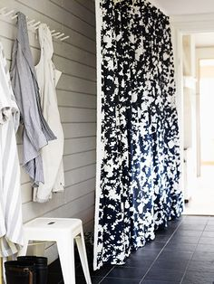 "i kind of like the idea of a curtain to hide the inevitable""clutter wall"" in the mudroom"