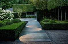 Delta Lighting's Flip Path Lights used beautifully to create a pattern by staggering lights. via Gardenista