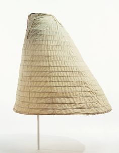 "Crinoline: second half of the 1860's, cotton with nineteen steel-wire hoops. ""...With the appearance of the cage crinoline, which was easy to put on and take off, the skirt continued to expand, and reached its maximum size in the mid 1860s. The cage crinoline grew out of proportion, and it was troublesome just to walk or pass through a door; this made everyday life difficult, and criticism of the crinoline grew in response..."""