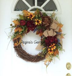 Summer Fall Wreath-Autumn Door Wreath-Farmhouse Wreath-Rustic Wreath-Country Wreath-Farmhouse Decor-Country Cottage Wreath-Summer Wreath This cheery farmhouse wreath is a lovely mixture of color that is perfect for the upcoming months. A natural, rustic grapevine wreath is covered with hydrangeas, dahlias, lavender and black-eyed Susans. Seeded eucalyptus, golden yellow maple leaves, garden ferns and other foliages make the design look natural and garden-like. Deep burgundy berries are…