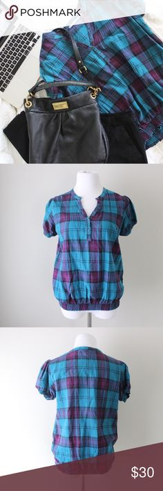 Urban Outfitters Plaid Cap Sleeve Stretch Blouse Super cute Urban Outfitters Kimchi Blue plaid cap sleeve blouse with elastic waist and hems.  Fits true to size.  Shown on a size 4/6 mannequin.  In gently used good condition.  Measurements available upon request.  All orders ship same or next business day! Urban Outfitters Tops