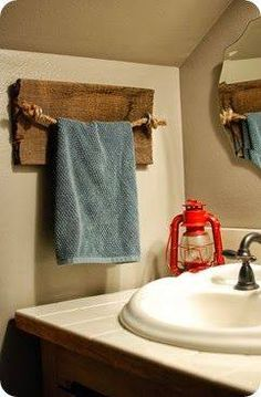 a rustic DIY rope and barn wood towel holder for the bathroom / powder room on w. a rustic DIY rop Home Diy, Barn Wood Decor, Cabin Decor, Rustic House, Rustic Diy, Boys Bathroom, Bathroom Decor, Decorating Blogs, Rustic Home Decor