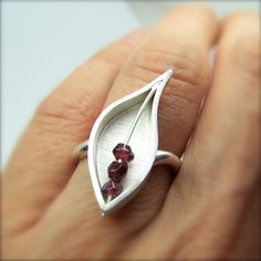 Ring | Nangijala Jewelry Designs.  Sterling silver with garnet beads.