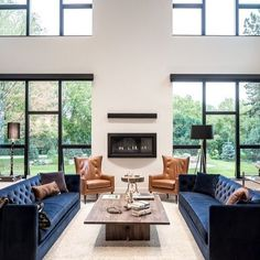 The living room color schemes to give the impression of more colorful living. Find pretty living room color scheme ideas that speak your personality. Bay Window Living Room, Rugs In Living Room, Living Room Color Schemes, Living Room Designs, Contemporary Family Rooms, Family Room Design, Cool House Designs, Room Colors, Room Decor