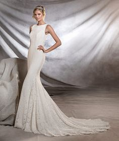 ORNANI - Lace wedding dress, bateau neckline, fitted to the hips Available at Bowties Bridal: (702) 456-5688
