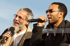 Folk artist Yusuf (formerly Cat Stevens) (L) performs with John Legend at Jon Stewart and Stephen Colbert's 'Rally to Restore Sanity and/or Fear' on October 30, 2010 in Washington, DC.