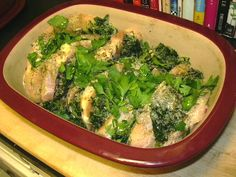 Greek Chicken made in an earthware pan, comprised of chicken breasts, 1/2 water, onion powder, feta cheese, thawed frozen spinach, black pepper, oregano, parsley and thyme.  It's baked for 30 min or so at 300 deg.  DELICIOUS!!!!