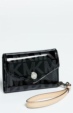 I love anything  everything made by this man--->MICHAEL Michael Kors Signature iPhone Wristlet   Nordstrom http://fashionbagarea.blogspot.com/  $159 Want! #chanel channel bags,channel for men,channel for women,chanel handbags