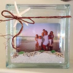 Vacation Memories using the sand and sea shells from the beach(es) visited.