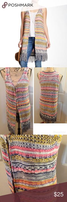"Paper Crane Fringe Hem Long Knit Vest A sleeveless open front topper features bright multi-color knit construction with fringe trim at the hem. - Open front - Sleeveless - Approx. 37"" length /  - 90% acrylic, 10% polyester / Great like new condition Paper Crane Sweaters Cardigans"
