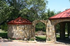 Rainwater collection cistern with aqueduct archway, and fire circle.