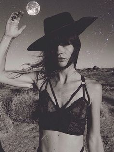 Beautiful brunette lingerie moonlight hat monochrome black and white