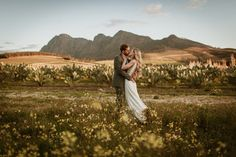 Destination Wedding in South Africa.  These two got married on a sunny Winters afternoon at the picturesque garden wedding venue @ Babylonstoren.  If you love nature and all things artisan and earthy - you'll love this place!   Mountain in the backdrop - Simonsberg.  www.kikitography.com