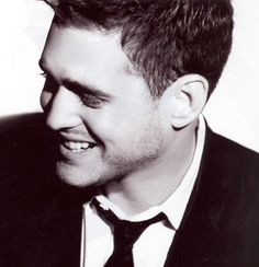 Michael Buble' - for his beautiful music and his gorgeous smile, eyes, style, ....... !! Won't you please come to Atlanta??!!