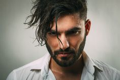Portrait of a man with a beard and wet face