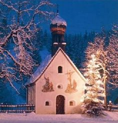 Even in its humblest attire, aglow beside a tiny chapel in Germany's Karwendel mountains, a Christmas tree is a wondrous sight.