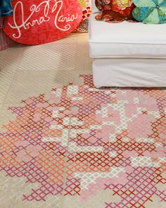 Trend Alert: cross-stitch-painted floors, walls and cross stich look rugsand peg boards