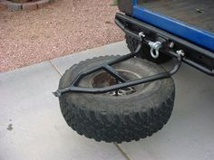 New swing down tire carrier - better if tire was on inside so it would be on top when opened not bottom like now