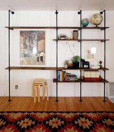 may have already pinned this...amazing DIY shelving made with wood and piping
