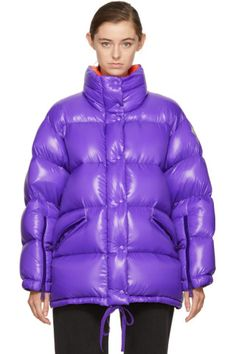 Long sleeve down-filled quilted nylon jacket in purple. Stand collar. Concealed two-way zip closure with press-stud placket at front. Zippered pockets at waist. Felted logo patch at upper sleeve. Zippered vent at cuffs. Drawstring-adjustable waistband and hem. Tonal hardware. Tonal stitching. Fill: 90% down, 10% feathers.