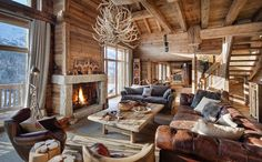 Great Fireplace for Great Room - Luxury Ski Chalet Meribel, France. Photo:©Leo Trippi Adore this cosy log cabin! Would be the perfect place to come back to after a day on the slopes.