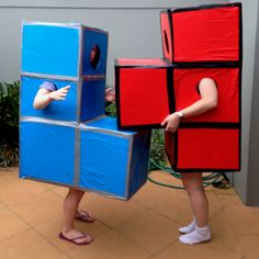 A tetris costume for a computer game themed party. Both units were made from 4 identical cardboard boxes, cut and arranged with duct tape. After arm and face openings were made, coloured wrapping paper was applied with spray adhesive and finished with additional duct tape to define edges.