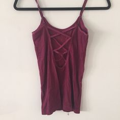 Free People Crisscross Back Cami Maroon Free People stretchy tank with crisscross open back. Super cute and comfortable! Great condition! Free People Tops Camisoles